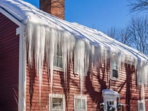 36772665 - ice dams and snow on roof and gutters
